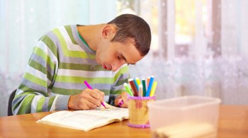 young adult man engages in self study, in rehabilitation center